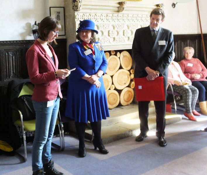 Leah Stewart reading two poems, with Lord Peel and Lord Lieutenant.
